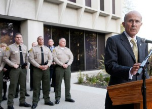 Sheriff Lee Baca in Los Angeles on Monday after 18 of his officers were indicted in a federal inquiry